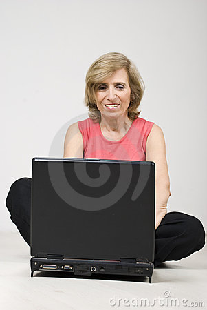Mature woman sitting on floor