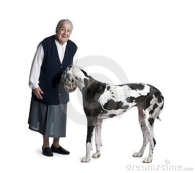 Mature woman standing with Great Dane dog