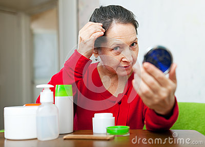 Mature woman stares on grizzled hair