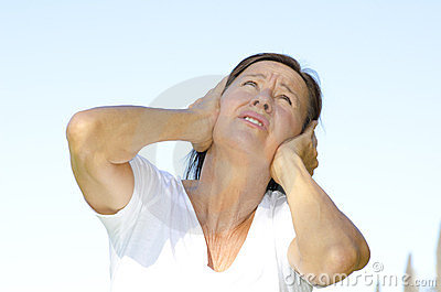 Mature woman stressed by noise