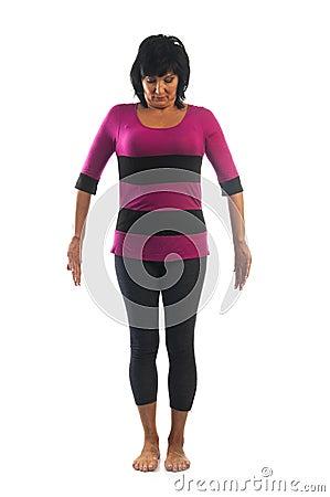 mature woman in tadasana pose