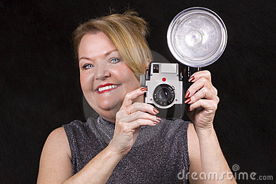 Mature woman taking pictures.