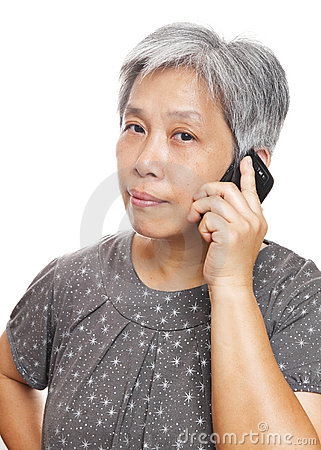 Mature woman using mobile phone