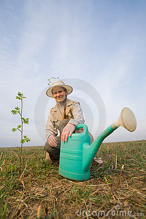 Mature woman with watering can