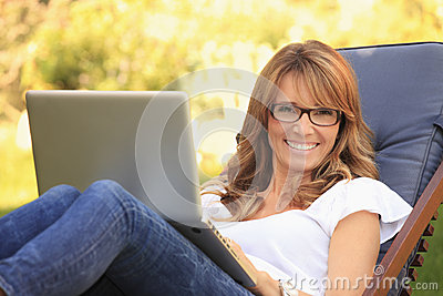 A mature woman working at home