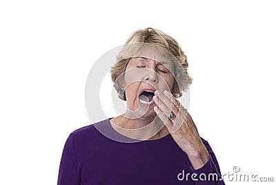 Mature woman yawning