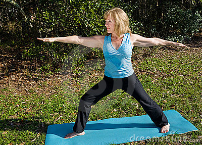 Mature Woman Yoga - Warrior Asana