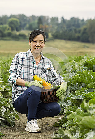 Mature women kneeling in vegetable Garden