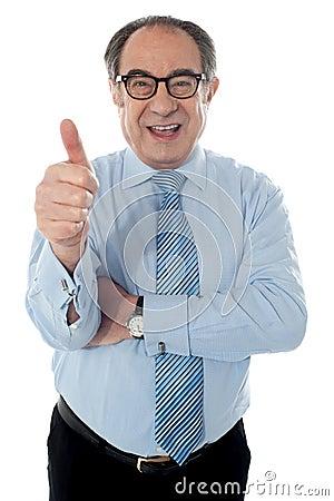 Matured businessman gesturing thumbs-up