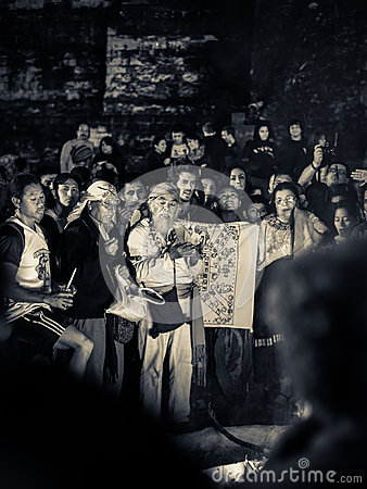 Mayan elder in crowd - Tikal, Guatemala Editorial Stock Image