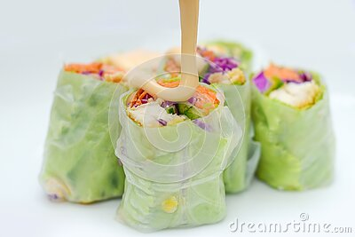 mayonnaise on a salad roll made from vegetable ingredients such as carrots, cabbage, purple cabbage, cucumber, roasted chicken Stock Photo