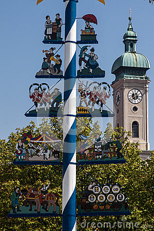 Maypole and Heilig Geist church Munich Germany