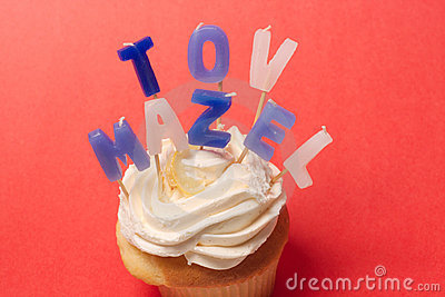 Mazel Tov candles on cupcake