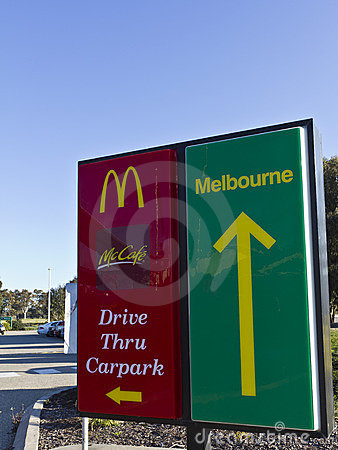 McDonalds drive through and carpark entry signs Editorial Stock Image