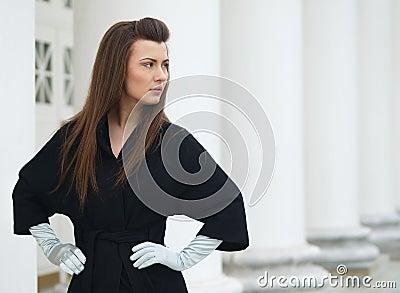 Mädchen in einem Mantel