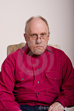Mean Looking Man in Red Shirt