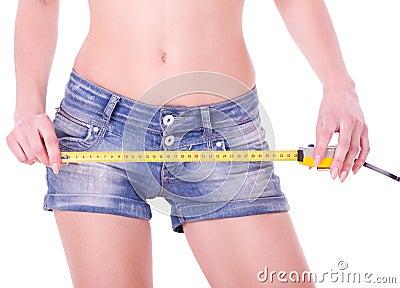 Measure on beautiful woman shorts