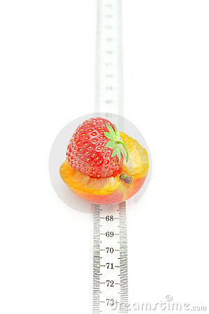 Measure tape,apricot  and strawberries