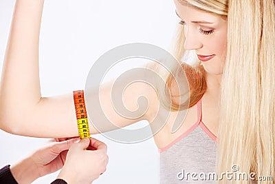 Measure tape around arm