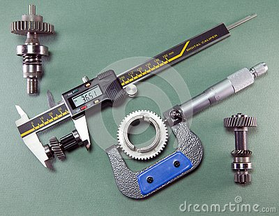 Measurement of the details by a digital caliper and a mechanical micrometer Stock Photo