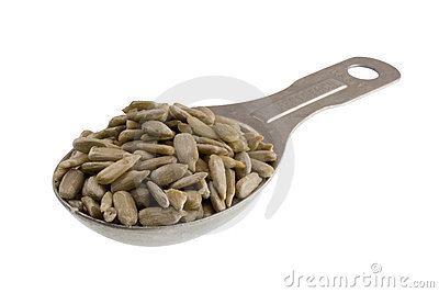 Measuring tablespoon of sunflower seeds