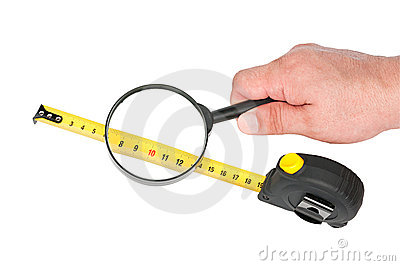 Measuring tool a roulette  and magnifier in hand