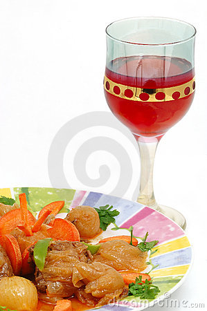 Meat dish with a red glass