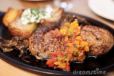 Meat dish - schnitzels, fried potato and garnish