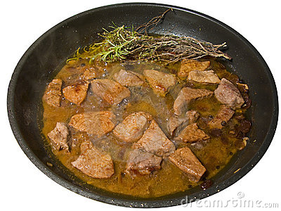 Meat in a frying pan, isolated