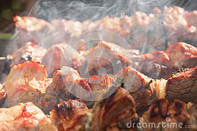 Meat grilling over charcoal