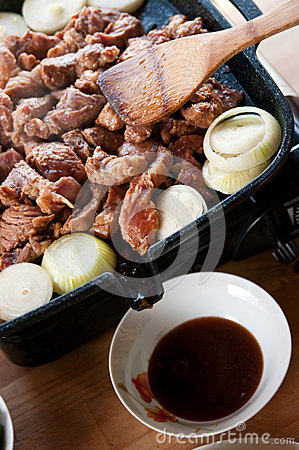Meat onions cooking grill
