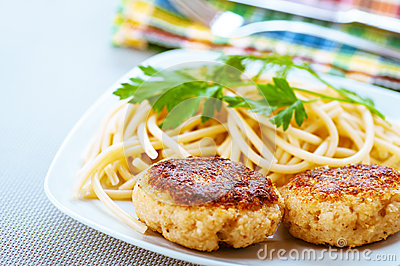 Meat patties and pasta with parsley