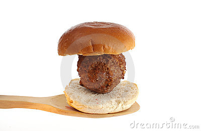 Meatball on a bun on a wooden spoon