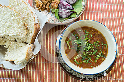 Meatball soup with onion