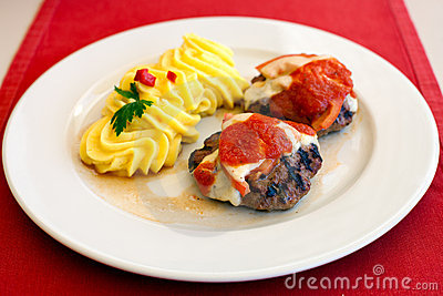 Meatballs with cheese, tomato and mashed potatoes