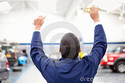 Mechanic with arms up