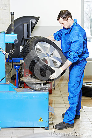Mechanic at auto wheel tyre changer
