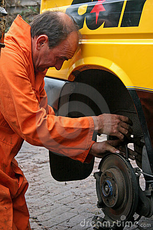 Mechanic changing brake disc