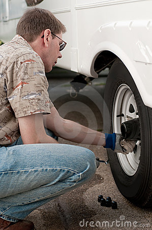Mechanic Checking Lug Nuts on Truck Wheels