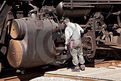Mechanic checks locomotive Editorial Stock Image