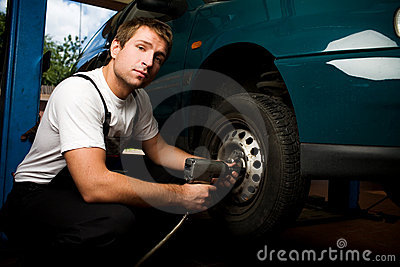 Mechanic fixing auto in car service
