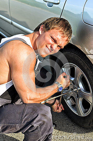 Mechanic fixing a tire