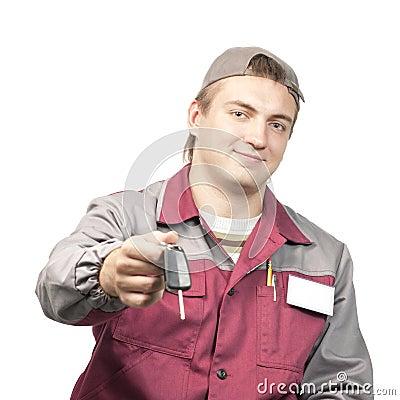 Mechanic giving a car key