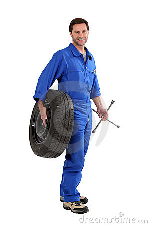 Free Mechanic Holding A Tire Stock Image - 22630221
