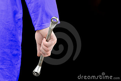 Mechanic holding a tool in his hand