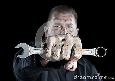 Mechanic holding wrench