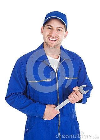 Free Mechanic In Blue Overalls Holding Spanner Stock Photos - 51629483