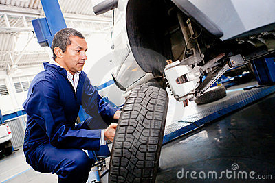 Mechanic placing a wheel