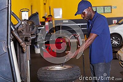 Mechanic pumping tyre