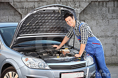 Mechanic searching for a car problem